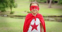 Masked girl pretending to be superhero Stock Footage