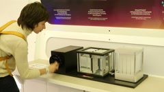 Woman tries a scientific instrument in action in cognitive museum - stock footage