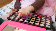 Little child girl first cosmetic tool kit for make-up painting coloring face  - stock footage