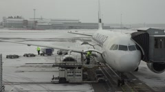 Filling the aircraft at a Swedish airport Arlanda Stock Footage