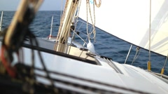 Sailing in the wind through the waves. Sailing boat shot at the Mediteranean sea - stock footage