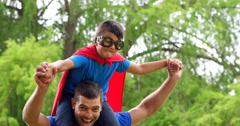 Father giving piggy back to son Stock Footage