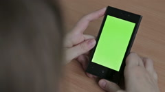 Female hands using cell phone, green screen - stock footage