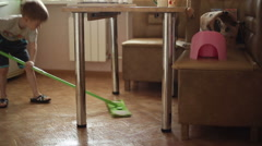 The boy helps parents to do housework Stock Footage