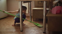 The girl helps parents to do housework Stock Footage