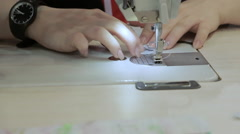 Close up on a sewing machine showing process. Stock Footage