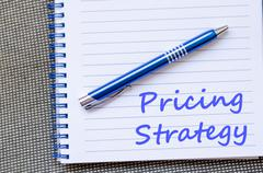 Pricing strategy write on notebook Stock Photos