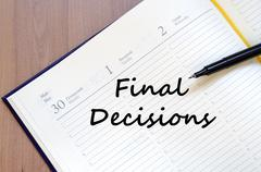 Final decisions write on notebook Stock Photos