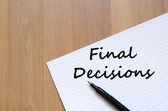 Stock Photo of Final decisions write on notebook