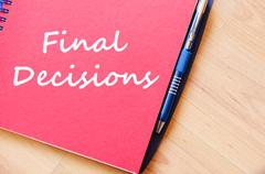 Final decisions write on notebook - stock photo