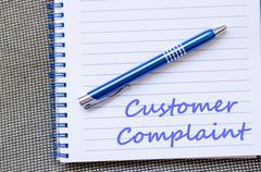 Customer complaint write on notebook Stock Photos