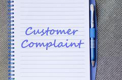 Customer complaint write on notebook - stock photo