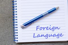 Foreign language write on notebook Stock Photos