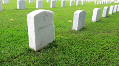 American army cemetery site. Many white marble headstones in rows Stock Footage