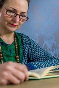 Woman reading book Stock Photos