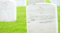 US soldiers graves on green grass. National cemetery site Stock Footage