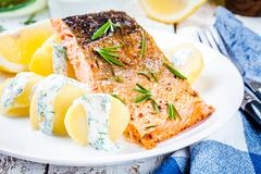 Baked salmon fillet and boiled potatoes - stock photo
