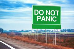 Do not panic road sign by the freeway Stock Photos