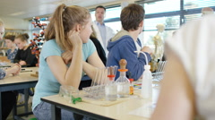 4K Teacher teaching group of students in school science class Stock Footage