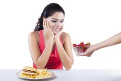 Indian Girl Receive Strawberry - stock photo
