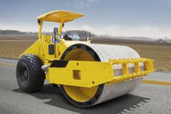 Roller compactor machine on the road Kuvituskuvat