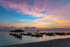 sunrise at Koh Lipe island and Longtail boat - Thailand - stock photo