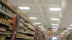 Moving through the pasta and sauce aisles of a large grocery store - stock footage