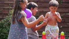Balloon bursting, the boy cries Stock Footage