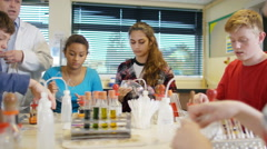 4K Teacher teaching group of students in school science class - stock footage