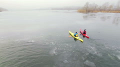 Aerial view of athlete relaxes in a kayak. Winter. Ice. - stock footage