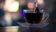 Brewing hot black tea in cafe Stock Footage
