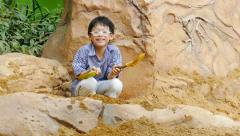 Young boy playing in the sandbox Stock Footage