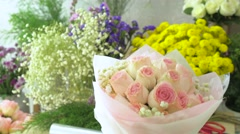 Flower shop, hand of florist arranging rose bouquet - stock footage