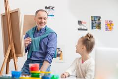 Stock Photo of Now I will teach you to paint