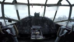 Walking through plane towards and old ancient cockpit showing windows 4k Stock Footage