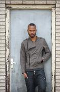 Portrait of a black male model posing - stock photo