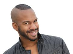 Handsome young african american male model smiling - stock photo