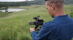African or African American cameraman operating video - stock footage