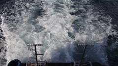Waves and foam from the boat engine Stock Footage
