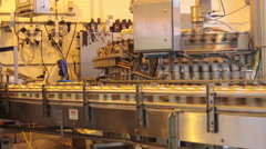 Pottsville, PA, USA - October 20, 2014 :  Cans moving on an assembly line on  Stock Footage
