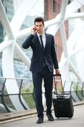 Businessman calling on phone and traveling with bag at metro station Stock Photos