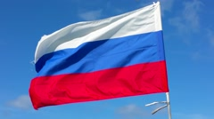 Russian flag waving in the wind, at bavaro beach in domenican republic Stock Footage