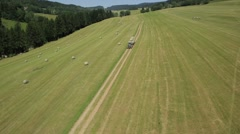Aerial View of Truck carrying hay bales in field, Great French Southeast - stock footage