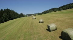 Aerial View of Forklift loading hay bales in truck - stock footage