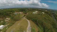 Aerial View of houses on hill in Sainte-Anne Stock Footage