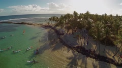 Aerial View of Tourists with kayaks and surfboard in tropical beach, Sainte-Anne - stock footage