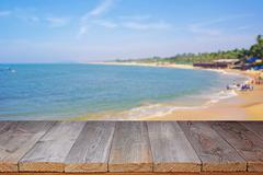 Wooden flooring against the sea coast. - stock photo