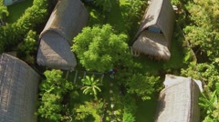Aerial View of Couple walking in garden of resort, Jimbaran, Bali, Indonesia Stock Footage