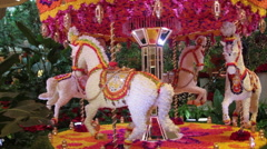 Vintage Carousel with horses made from  various flowers Stock Footage