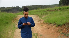 African or African American man texting on cellphone Stock Footage